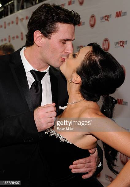 Adult film actor/director Manuel Ferrara kisses adult film actress Katsuni as they arrive at the 29th annual Adult Video News Awards Show at the Hard...