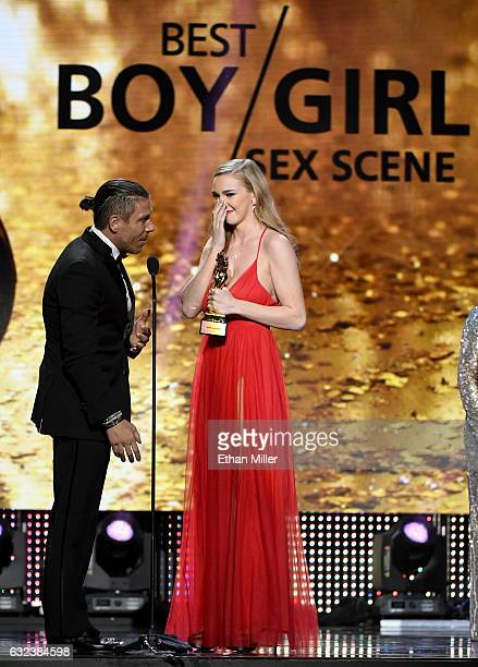 Adult film actor/director Mick Blue and adult film actress Kendra Sunderland accept the award for Best Boy/Girl Sex Scene during the 2017 Adult Video...