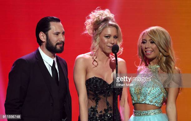 Adult film actor/director Tommy Pistol and adult film actresses Katie Morgan and Kat Dior present an award during the 2018 Adult Video News Awards at...