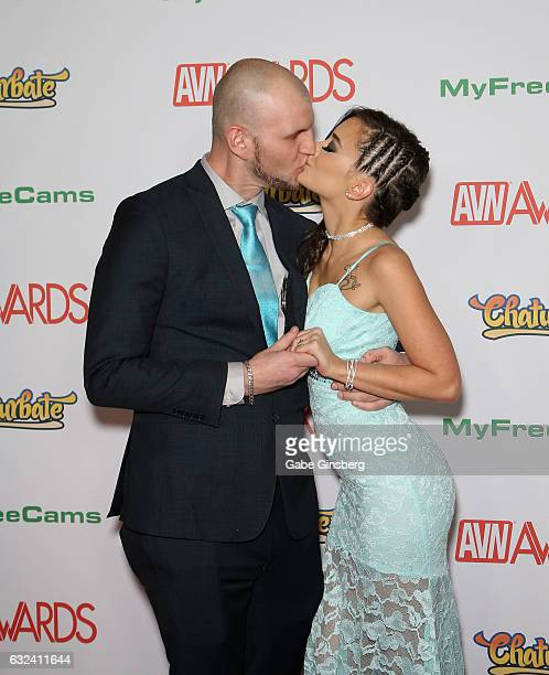 Adult film actor/producer Brian Omally kisses adult film actress Gia Paige as they attend the 2017 Adult Video News Awards at the Hard Rock Hotel...