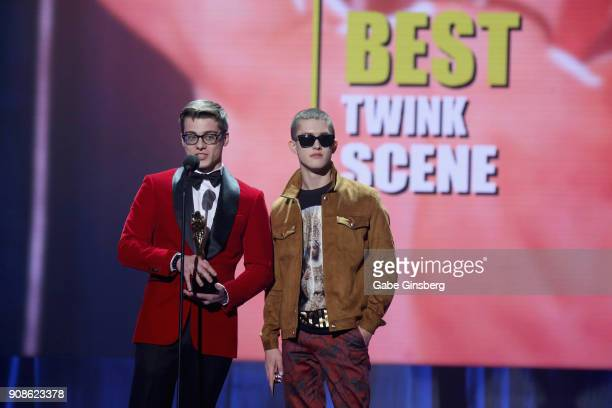 Adult film actors Blake Mitchell and Sean Ford win an award during the 2018 GayVN Awards show at The Joint inside the Hard Rock Hotel Casino on...