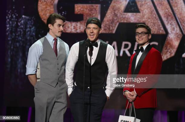 Adult film actors Jack Hunter JJ Knight and Blake Mitchell present an award during the 2018 GayVN Awards show at The Joint inside the Hard Rock Hotel...