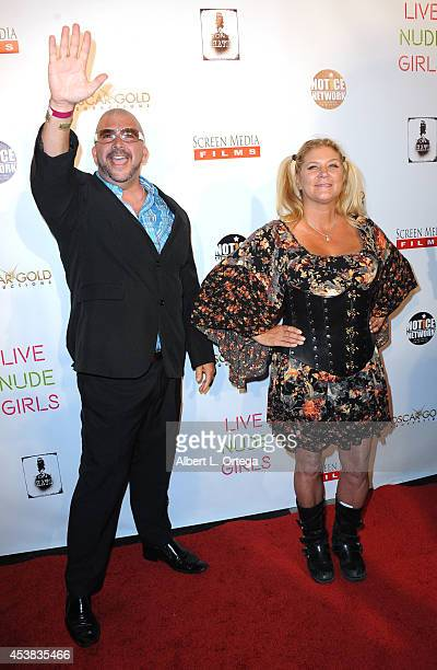 Adult film actors James Bartholet and Ginger Lynn arrive at the premiere of Live Nude Girls held at Avalon on August 12 2014 in Hollywood California