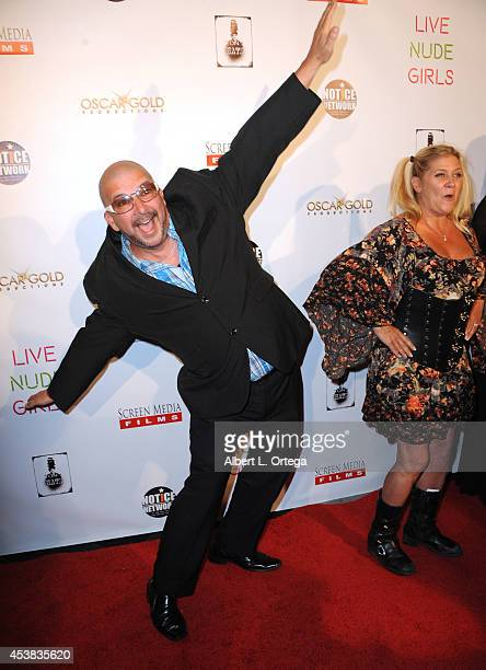 """Adult film actors James Bartholet and Ginger Lynn arrive at the premiere of """"Live Nude Girls"""" held at Avalon on August 12, 2014 in Hollywood,..."""