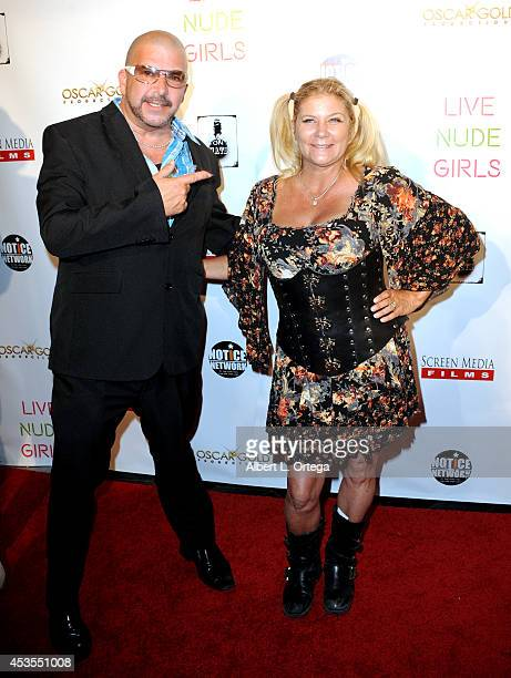 """Adult film actors James Bartholet and Ginger Lynn arrive for the Premiere Of """"Live Nude Girls"""" held at Avalon on August 12, 2014 in Hollywood,..."""