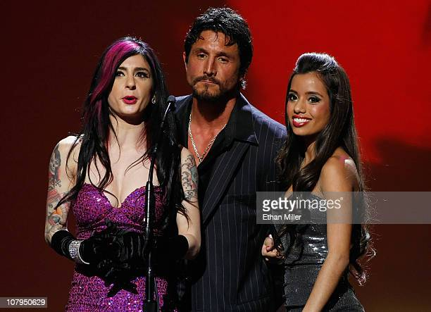 Adult film actors Joanna Angel Tommy Gunn and Lupe Fuentes present an award at the 28th annual Adult Video News Awards Show at The Pearl concert...