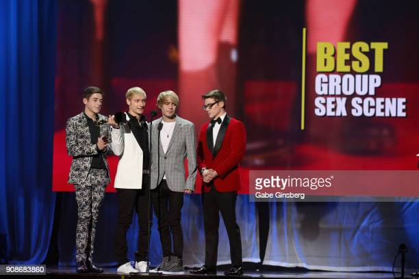 Adult film actors Joey Mills Max Carter Kyle Ross and Blake Mitchell win an award during the 2018 GayVN Awards show at The Joint inside the Hard Rock...
