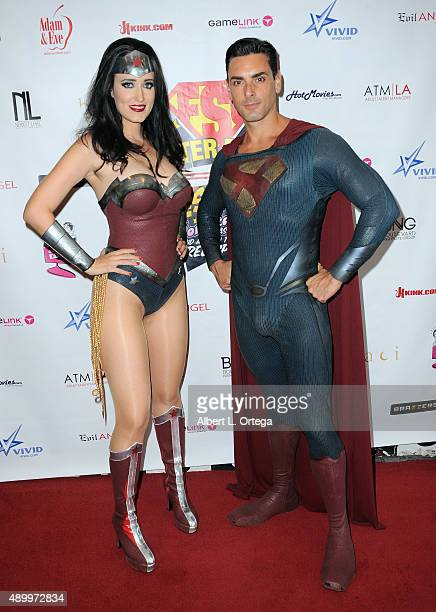 Adult film actors Kimberly Kane as Wonder Woman and Ryan Driller as Superman at FSC After Dark Capes Panties A Superhero Costume Lingerie Auction and...