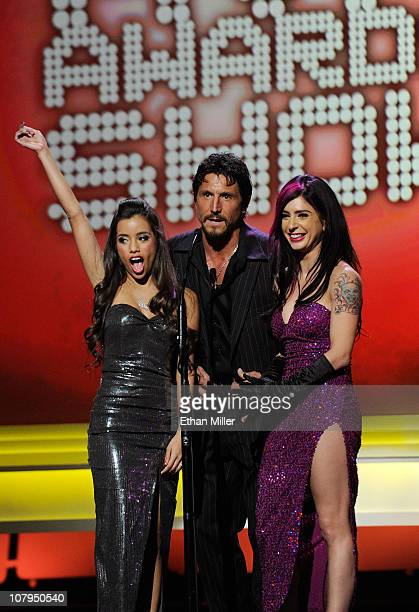 Adult film actors Lupe Fuentes Tommy Gunn and Joanna Angel present an award at the 28th annual Adult Video News Awards Show at The Pearl concert...
