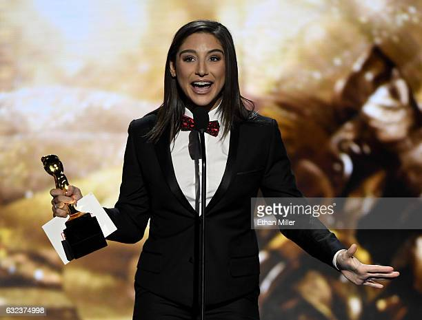 Adult film actress Abella Danger accepts the award for Best Star Showcase during the 2017 Adult Video News Awards at The Joint inside the Hard Rock...
