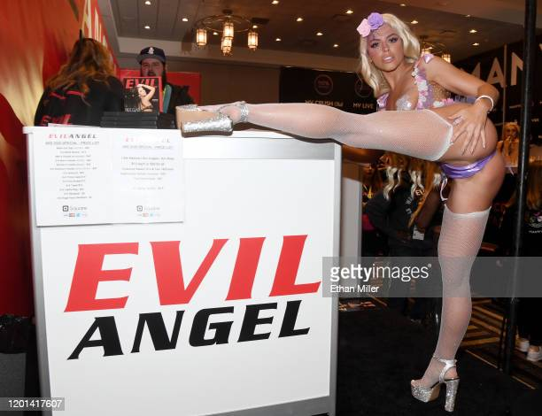 Adult film actress Adriana Chechik poses at the Evil Angel booth at the 2020 AVN Adult Entertainment Expo at the Hard Rock Hotel & Casino on January...