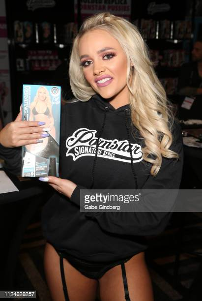 Adult film actress Alexis Monroe shows off a sex toy modeled after her in the Pornstar Signature series booth at the 2019 AVN Adult Entertainment...