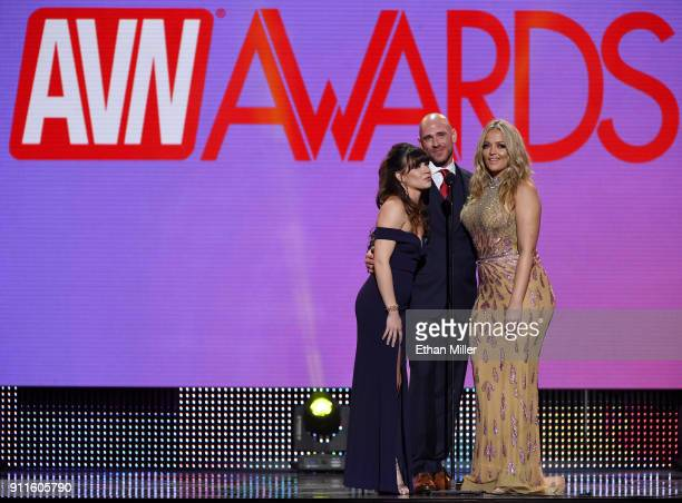 Adult film actress Alison Rey adult film actor Johnny Sins and adult film actress/director Alexis Texas present an award during the 2018 Adult Video...