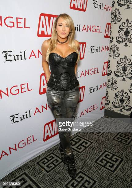 Adult film actress and comedian Brett Rossi poses in the AVN press room during the 2018 AVN Adult Expo at the Hard Rock Hotel Casino on January 25...