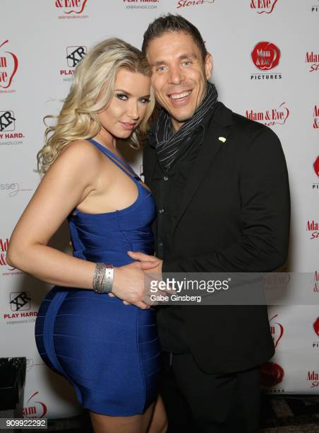 Adult film actress Anikka Albrite and her husband adult film actor/director Mick Blue pose at the Adam Eve booth during the 2018 AVN Adult Expo at...