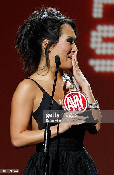 Adult film actress Asa Akira reacts after winning an award at the 28th annual Adult Video News Awards Show at The Pearl concert theater at the Palms...