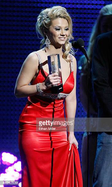 Adult film actress Ashlynn Brooke accepts the award for Best Interactive DVD during the 26th annual Adult Video News Awards Show at the Mandalay Bay...