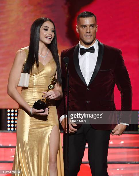 Adult Film Actress Avi Love And Adult Film Actor Ramon Nomar Accept The Award For Best