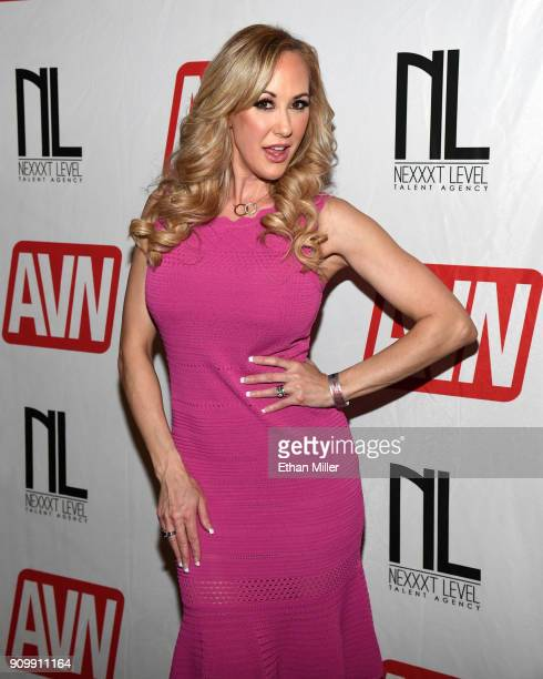 Adult film actress Brandi Love poses at the Nexxxt Level Talent booth at the 2018 AVN Adult Entertainment Expo at The Joint inside the Hard Rock...