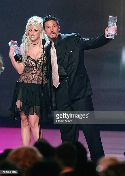 Adult film actress Brittany Skye and actor Tommy Gunn accept an award at the Adult Video News Awards Show at the Venetian Resort Hotel and Casino...