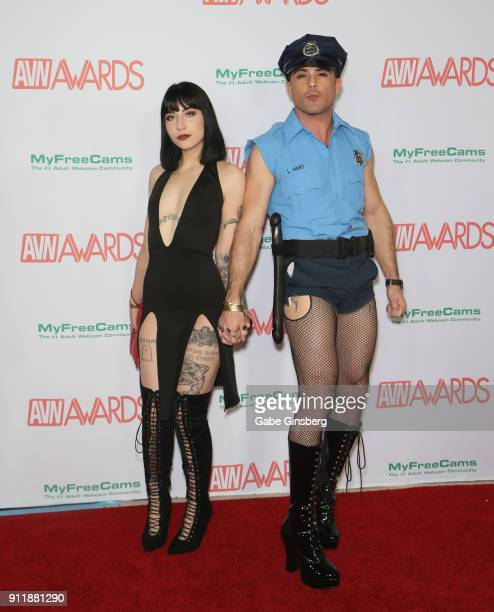 Adult film actress Charlotte Sartre and adult film actor Lance Hart dressed like a police officer attend the 2018 Adult Video News Awards at the Hard...