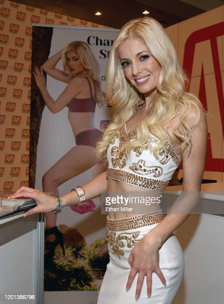 Adult film actress Charlotte Stokely poses at the AVN Stars booth at the 2020 AVN Adult Entertainment Expo at the Hard Rock Hotel Casino on January...