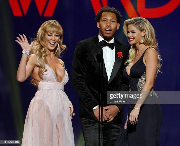 Adult film actress Cherie DeVille adult film actor Ricky Johnson and adult film actress Jessa Rhodes present an award during the 2018 Adult Video...
