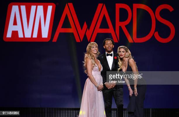 Adult film actress Cherie DeVille, adult film actor Ricky Johnson and adult film actress Jessa Rhodes present an award during the 2018 Adult Video...