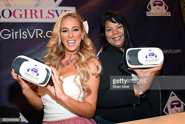 Adult film actress Cherie DeVille and HoloGirlsVR President and executive producer Anna Lee pose at the HoloGirlsVR booth at the 2017 AVN Adult...