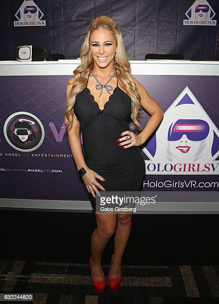 Adult film actress Cherie DeVille appears at the HoloGirls VR booth during the 2017 AVN Adult Entertainment Expo at the Hard Rock Hotel Casino on...