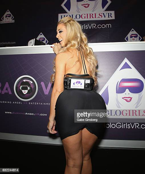 Adult film actress Cherie DeVille jokes around with a virtual reality headset at the HoloGirls VR booth during the 2017 AVN Adult Entertainment Expo...
