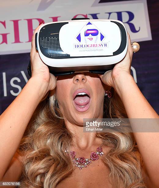 Adult film actress Cherie DeVille poses at the HoloGirlsVR booth at the 2017 AVN Adult Entertainment Expo at the Hard Rock Hotel Casino on January 18...