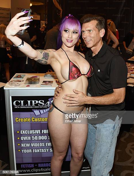 Adult film actress Daizha Morgann takes a photo with William Janes of California at the Clips4Salecom booth at the 2016 AVN Adult Entertainment Expo...