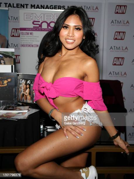 Adult film actress Ember Snow poses at the Adult Talent Managers booth during the 2020 AVN Adult Expo at The Joint inside the Hard Rock Hotel Casino...
