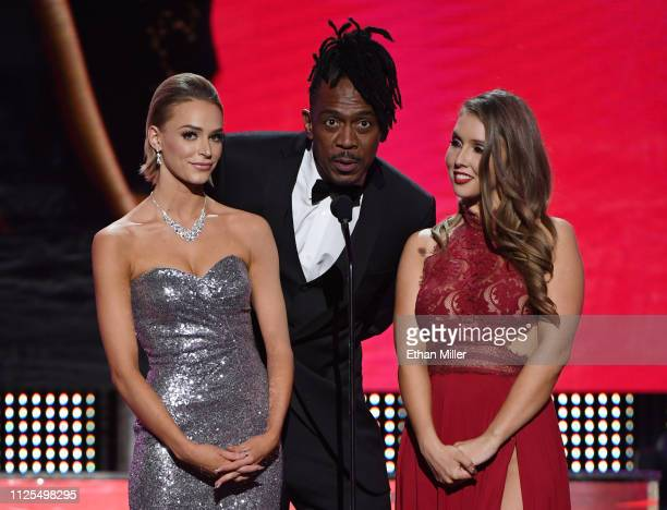 Adult film actress Emma Hix adult film actor Dredd and adult film actress Lena Paul present an award during the 2019 Adult Video News Awards at The...
