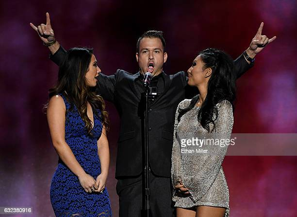 Adult film actress Eva Lovia, adult film actor Chad White and adult film actress/director Asa Akira present an award during the 2017 Adult Video News...