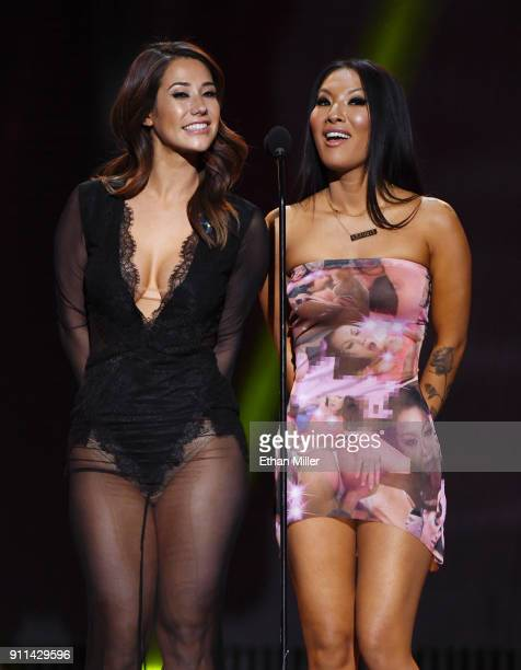 Adult film actress Eva Lovia and adult film actress/director Asa Akira present an award during the 2018 Adult Video News Awards at The Joint inside...