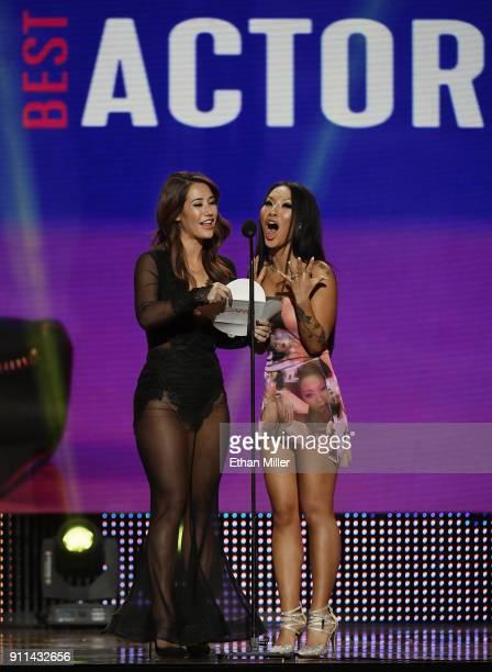 Adult film actress Eva Lovia and adult film actress/director Asa Akira present an award during the 2018 Adult Video News Awards at The Joint inside...