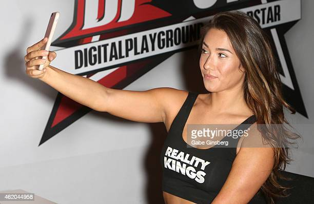 Adult film actress Eva Lovia takes a photo of herself during the 2015 AVN Adult Entertainment Expo at the Hard Rock Hotel & Casino on January 23,...