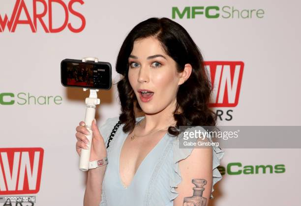 Adult film actress Evelyn Claire live streams from her phone during the 2020 Adult Video News Awards at The Joint inside the Hard Rock Hotel Casino...