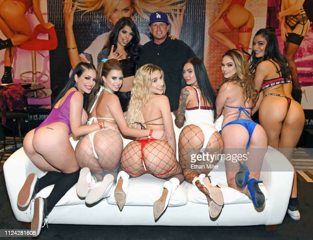 Adult film actress Gina Valentina and adult film producer/director Jules Jordan stand behind adult film actresses Kissa Sins, Jill Kassidy, Abella...