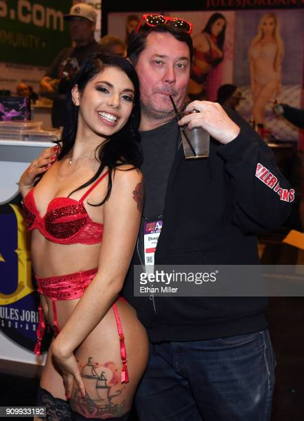 Adult film actress Gina Valentina and comedian/actor Doug Benson joke around at the Jules Jordan Video booth at the 2018 AVN Adult Entertainment Expo...