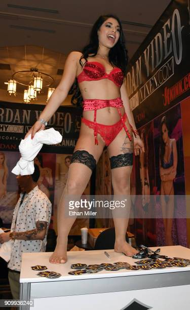 Adult film actress Gina Valentina dances at the Jules Jordan Video booth at the 2018 AVN Adult Entertainment Expo at the Hard Rock Hotel Casino on...