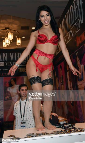 Adult film actress Gina Valentina dances at the Jules Jordan Video booth at the 2018 AVN Adult Entertainment Expo at the Hard Rock Hotel & Casino on...