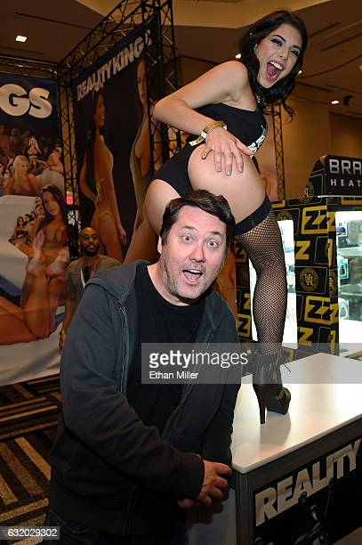 Adult film actress Gina Valentina jokes around with comedian/actor Doug Benson at the Reality Kings booth at the 2017 AVN Adult Entertainment Expo at...
