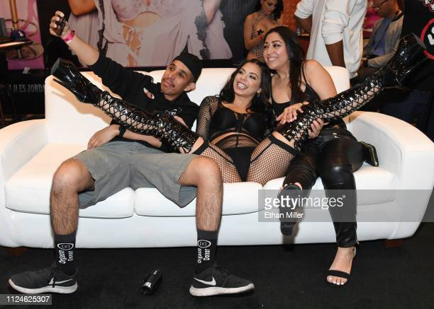 Adult film actress Gina Valentina poses for photos with Alejandro Cendejaz and Lucia Saldana both of Nevada at the Jules Jordan Video booth at the...