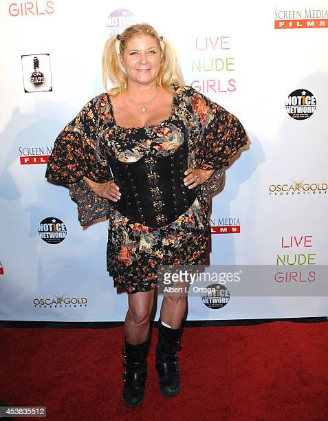 Adult film actress Ginger Lynn arrives at the premiere of Live Nude Girls held at Avalon on August 12 2014 in Hollywood California
