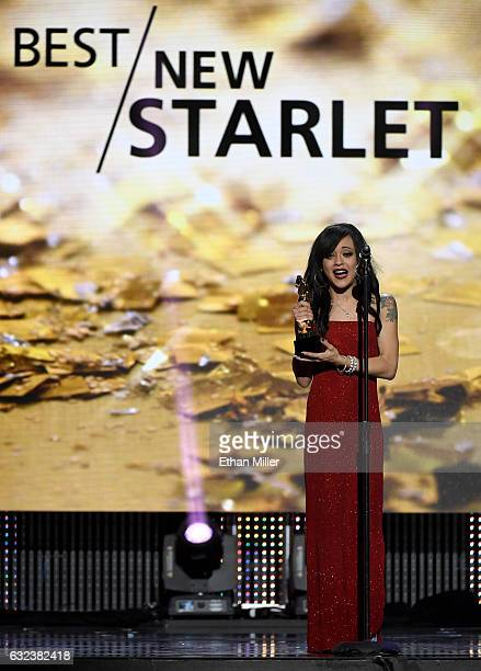 Adult film actress Holly Hendrix accepts the award for Best New Starlet during the 2017 Adult Video News Awards at The Joint inside the Hard Rock...