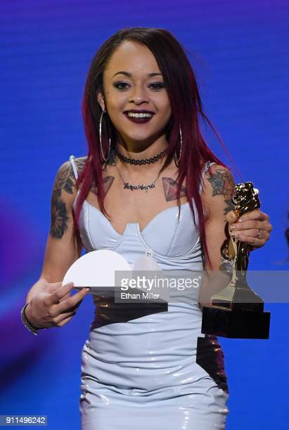 Adult film actress Holly Hendrix presents an award during the 2018 Adult Video News Awards at The Joint inside the Hard Rock Hotel Casino on January...