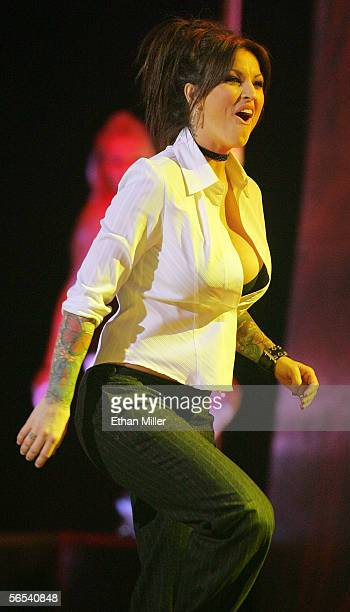Adult film actress Janine Lindemulder walks on stage to accept one of her awards at the Adult Video News Awards Show at the Venetian Resort Hotel and...